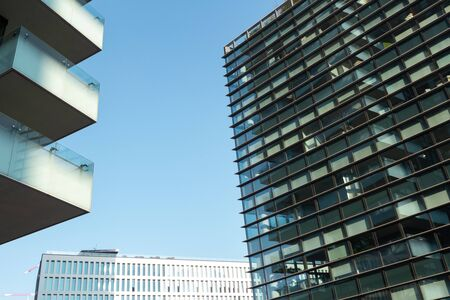 A huge office building with lots of windows against a blue sky. 01.2020 Milan