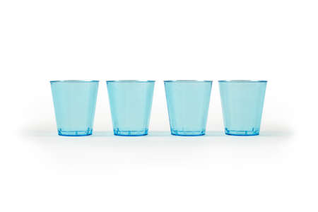 Side view of four blue glasses made from recycled plastic. Caring for the environment.