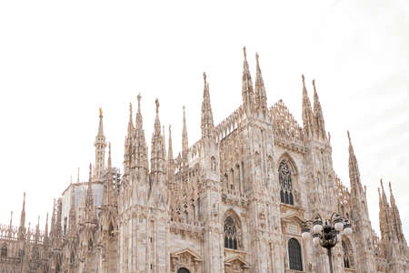 Bottom view of the historic building Duomo. Isolated on a white background. Milan, Italy.