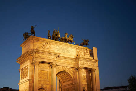 Arco della Pace or Arch of Peace in Milan, Italy, built as part of Foro Bonaparte to celebrate Napoleon's victories. It is city gate of Milan located at center of Simplon Square in Milan, Italy. Milan Italy
