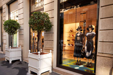 Contemporary showcase of a Dior store. Clothing store. Mannequins in fashionable beautiful dresses. Milan Italy 08.2020