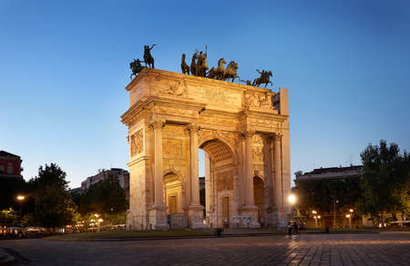 Arco della Pace or Arch of Peace in Milan, Italy, built as part of Foro Bonaparte to celebrate Napoleon's victories. It is city gate of Milan located at center of Simplon Square in Milan, Italy. Milan Italy 08.2020