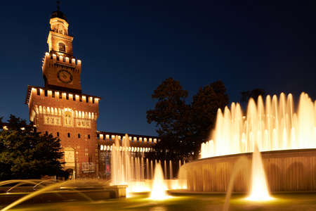 Beautiful view of Sforza Castle Castello Sforzesco with fountain at night, Milan, Italy. This old castle was built in 15th century by Francesco Sforza, Duke of Milano. Milan Italy 08.2020 Sajtókép