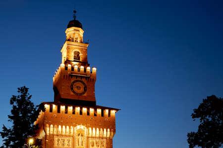 Large clock on the Castello Sforzesco castle. Popular tourist destination in Milan. Milan Italy 08.2020 Sajtókép