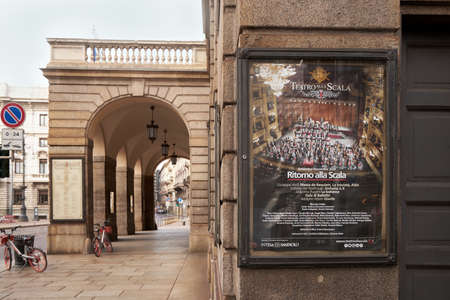 Modern signboard, ad Teatro alla Scala. Against the backdrop of a beautiful historic city. Milan, Italy. 08.2020