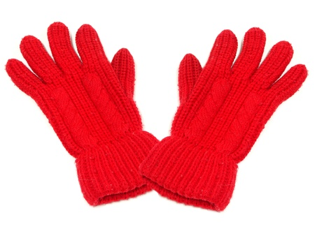 Pair of red woolen winter gloves isolated on white photo