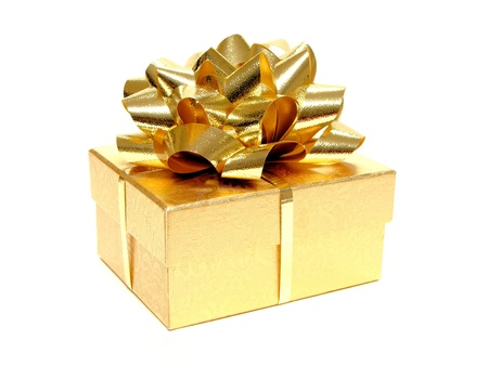 Small golden gift box with bow and ribbon on white