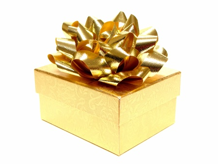 Small golden gift box with bow on white