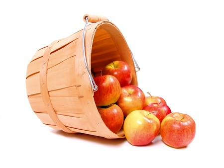 A group of apples spilling from a wooden farmer's basket