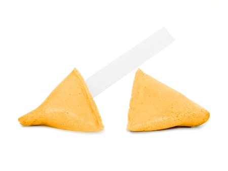 Broken fortune cookie with a blank message tag over white photo