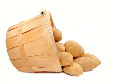 Potatoes in a wooden harvest basket photo