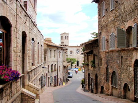 assisi: Medieval street in Assisi, Italy and the church San Pietro