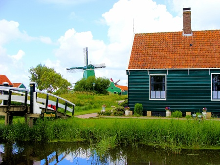 Traditional Dutch farmhouse and windmill  Stock Photo - 9784111