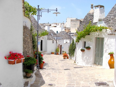 apulia: Pretty street among the trulli of Alberobello, Italy Stock Photo