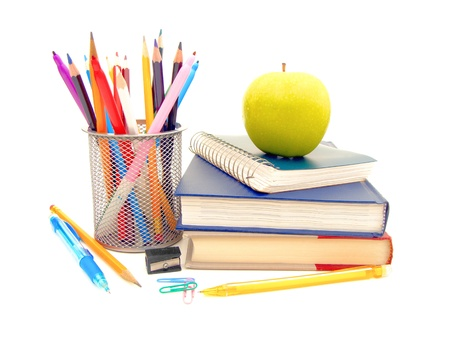 reading materials: Collection of various school supplies on a white background Stock Photo