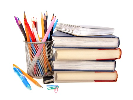 Collection of various school or office supplies on a white background photo