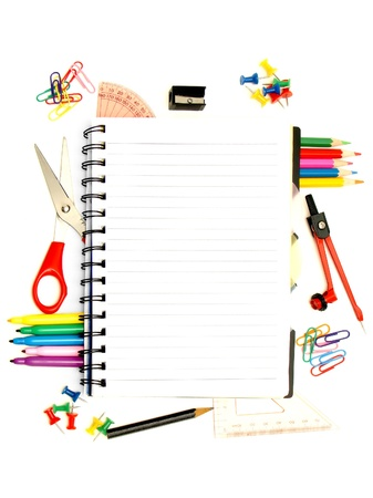 Blank notebook surrounded by a border of various school supplies photo