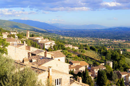 View over the hills of Umbria and the town of Assisi at dusk photo