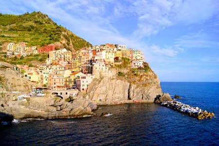 Beautiful view of the village of Manarola on the coast of Italy at sunset photo