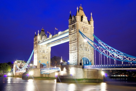 bridges: The iconic Tower Bridge of London lit up at night over the River Thames
