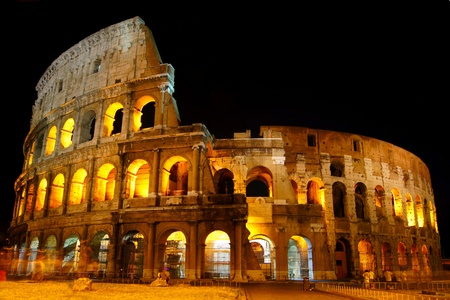 The Colosseum under the glow of lights at night, Rome Editorial