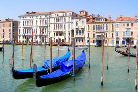 Gondolas resting outside the palaces lining the famous Grand Canal in Venice
