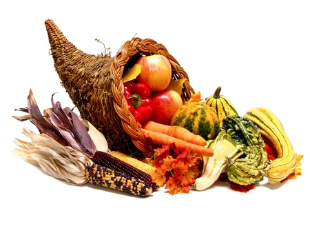 Thanksgiving or harvest cornucopia on a white background photo
