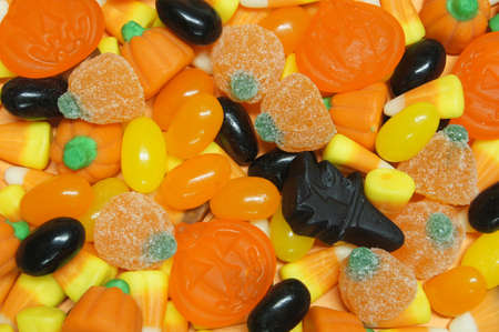 Halloween candy background with jellies, candy corn and gummies photo