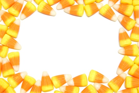 Halloween candy corn frame over white photo