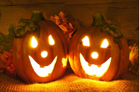 Night shot of two Halloween jack-o-lanterns with wooden background photo