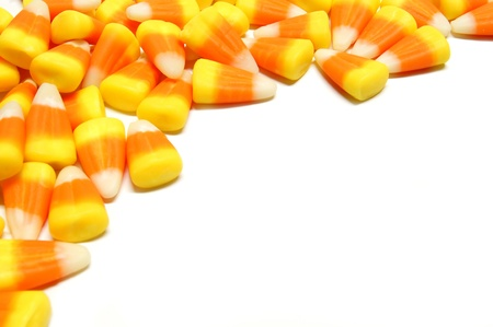 scattered on white background: Halloween candy corn corner border over white Stock Photo