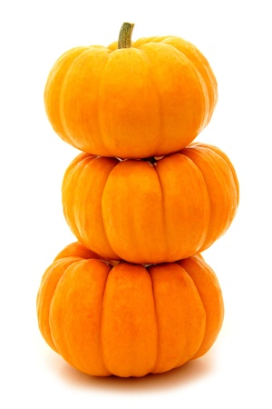 Three stacked mini pumpkins over white