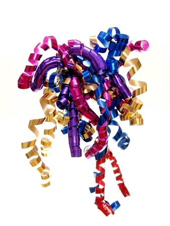 twirls: Colorful twirled party or gift ribbon over a white background Stock Photo