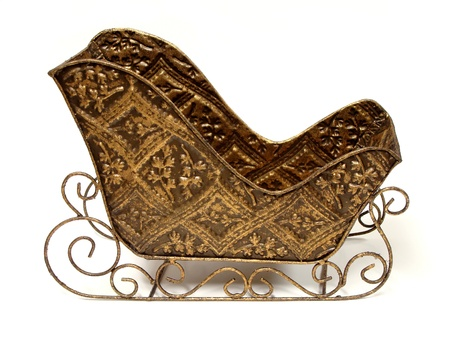 Empty ornamental Christmas sleigh over a white background