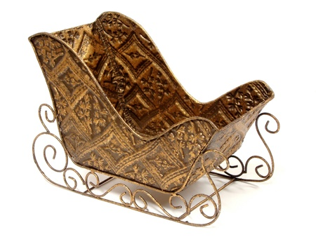 Empty ornamental Christmas sleigh over a white background photo