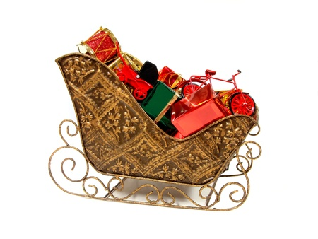 Santa Claus Sleigh filled with Colorful Gifts and Toys over white photo