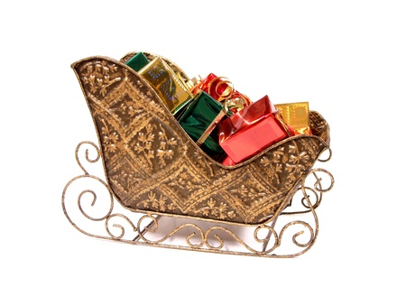 christmas sleigh: Decorative Christmas Sleigh filled with Colorful wrapped Gifts over white