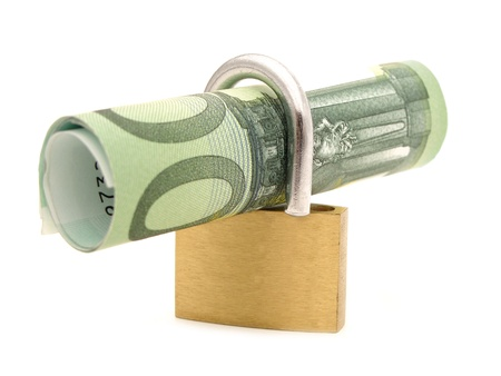 non cash: Rolled one hundred Euro note within a lock over white