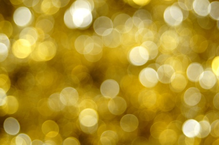 twinkles: Abstract gold Christmas light background Stock Photo