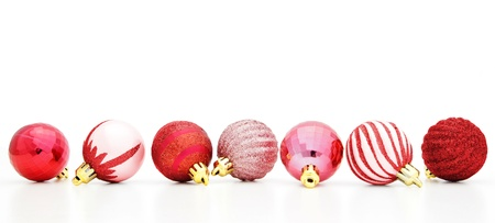 Red Christmas baubles arranged in row photo