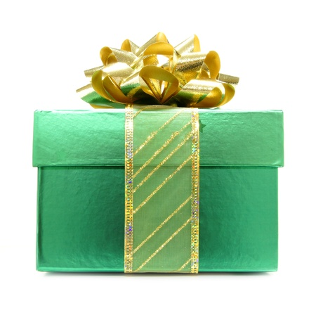 winter gift: Green Christmas Gift Box with Gold Bow and Ribbon Stock Photo