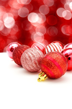 Red Christmas bauble arrangement with abstract twinkling light background photo