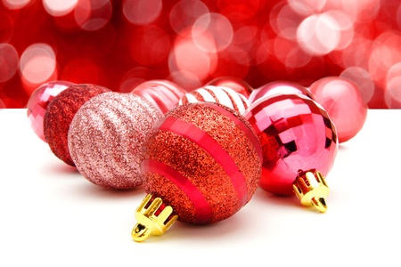 twinkling: Red Christmas bauble arrangement with abstract twinkling light background