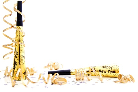 new years eve party noisemaker border with confetti and streamers over a white background stock photo