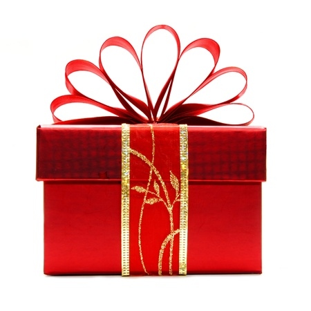 christmas gift: Red Christmas gift box with ribbon and bow isolated on a white background Stock Photo