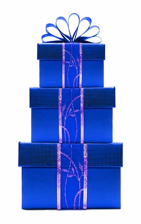 three presents: Stacked blue Christmas gift boxes with ribbon and bow isolated on white