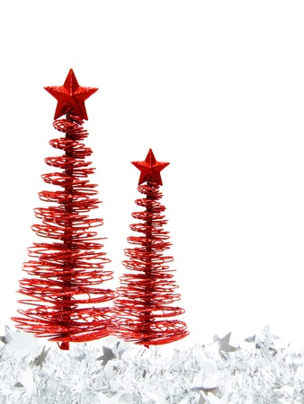 Vertical Christmas border of red trees and silver garland on a white background Stock Photo - 11413570