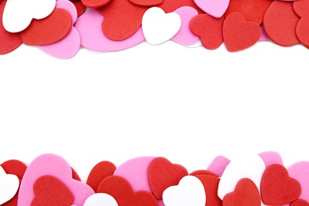 edge: Double border of textured Valentines Day heart-shaped confetti