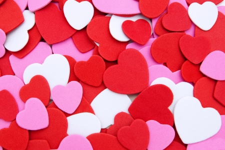 Colorful textured Valentines Day heart-shaped confetti background photo