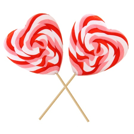 shaped: Two Valentines Day heart-shaped lollipops isolated on white